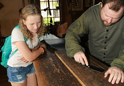 student learns about woodworking on a field trip to Black Creek Pioneer Village