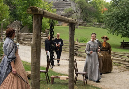 Visitors and history actors in costume at Black Creek Pioneer Village