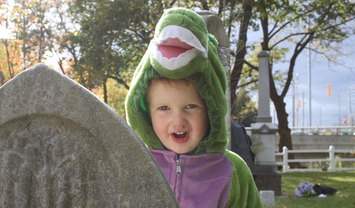 a little boy in costume at a Black Creek Pioneer Village Halloween celebration