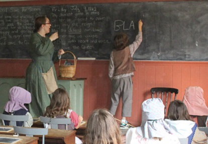 students take part in a re-creation of a pioneer school day