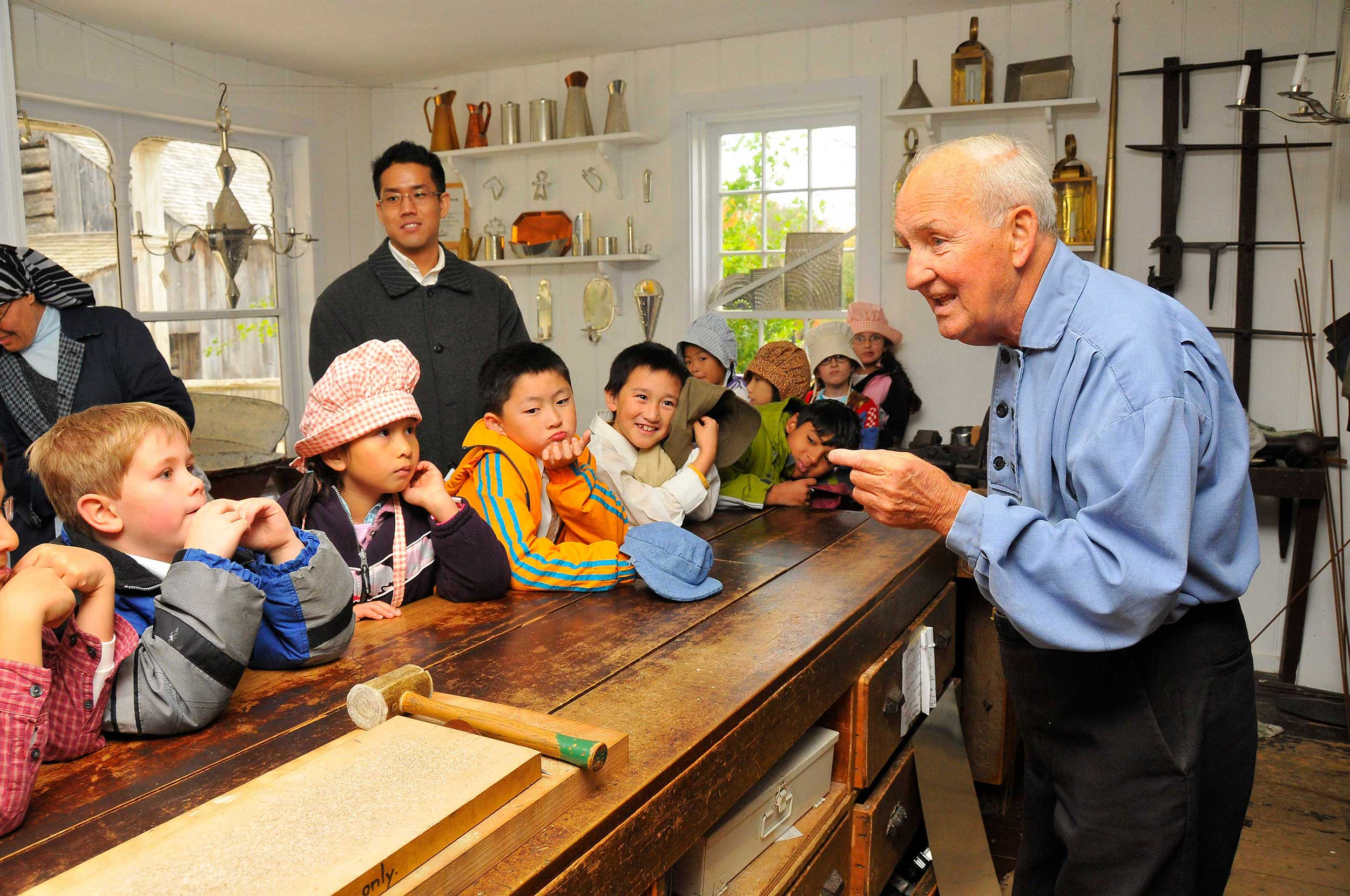 Kids learn about tin smith at the Tin Shop
