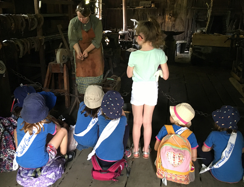 Children watch demonstration of traditional crafts at Black Creek Pioneer Village Guides and Scouts Day