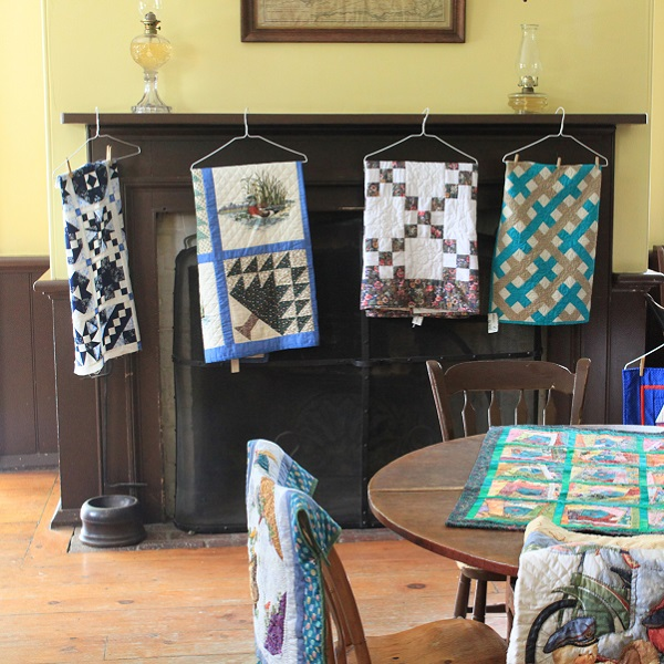 Quilts on display during Harvest Festival at Black Creek