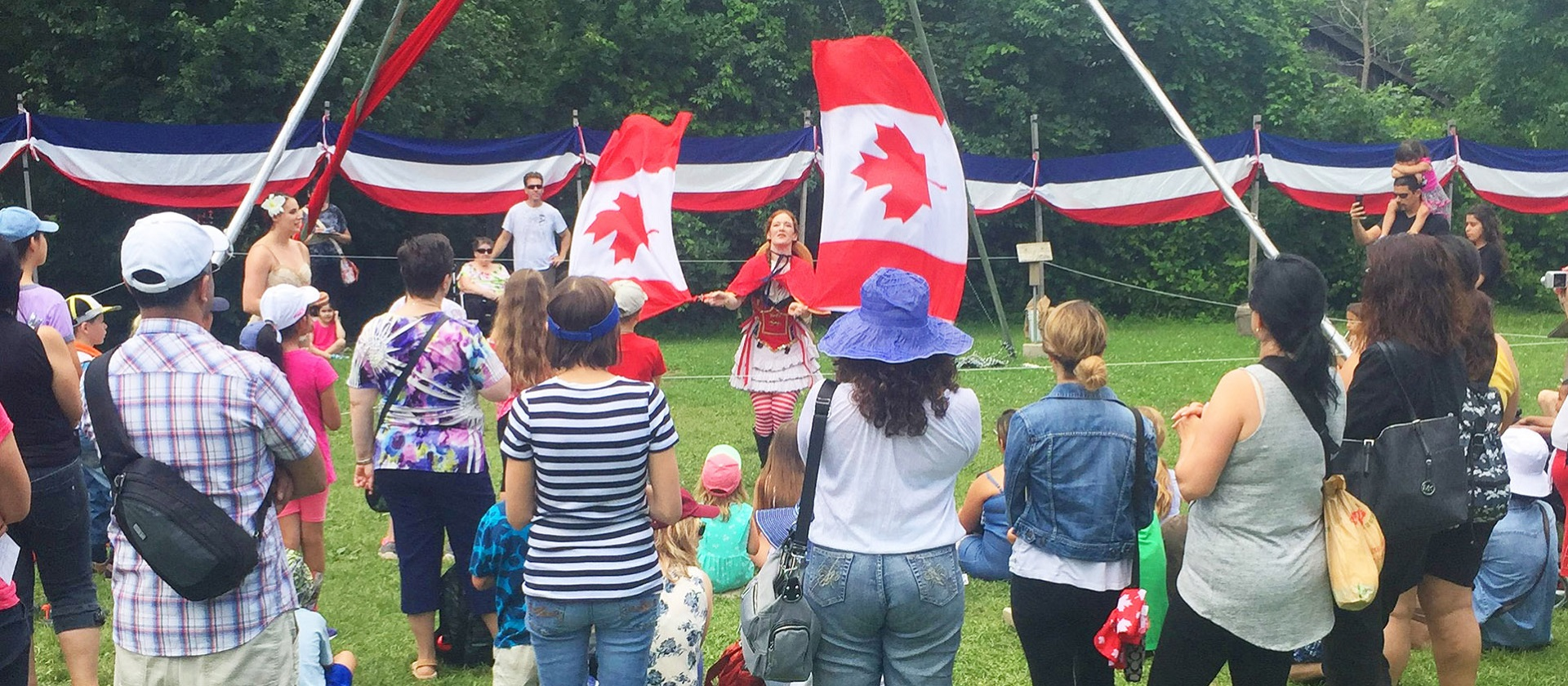 performer entertains a crowd at the Black Creek Pioneer Village 2017 Canada Day celebration