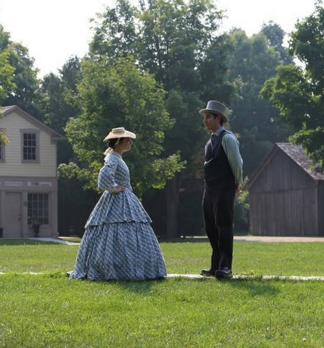 Man and Woman in 19th century clothes are having a conversation