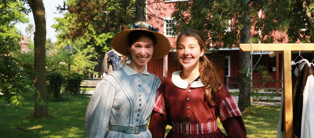 young girl and history actor in period costume