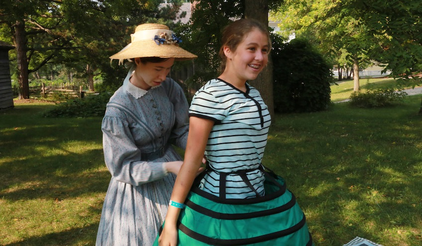 girl visits dress-up station during Black Creek home school day