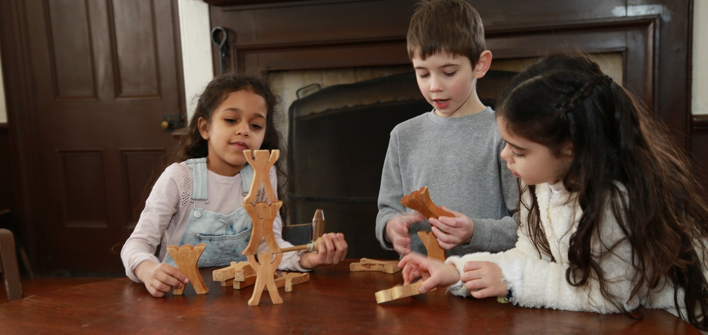 children play with wooden toys