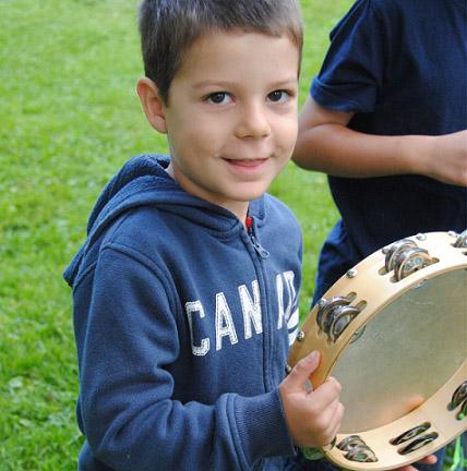 boy holding tambourine