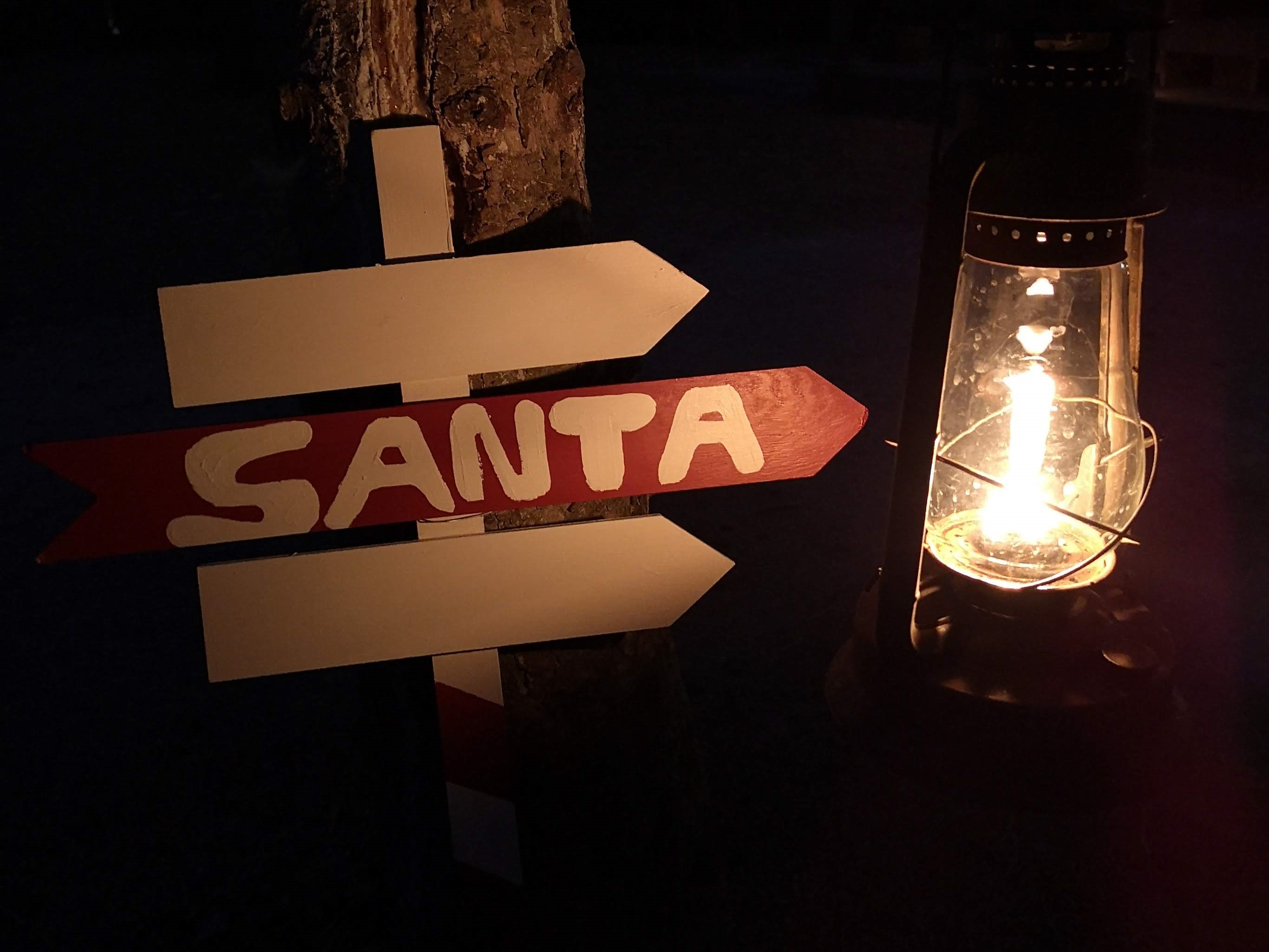 A sign pointing to the direction of Santa Clause