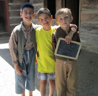 three boys in period costume at Black Creek Village summer day camp