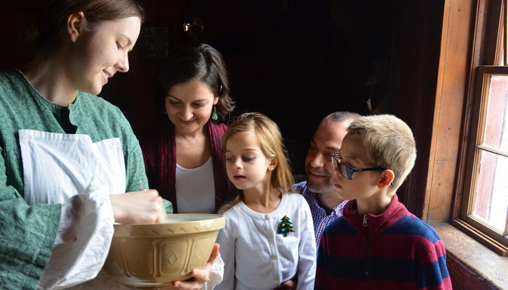 family enjoys holiday baking home school workshop at Black Creek Village