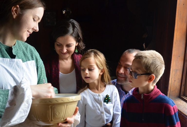 family enjoys holiday baking home school workshop at Black Creek Village