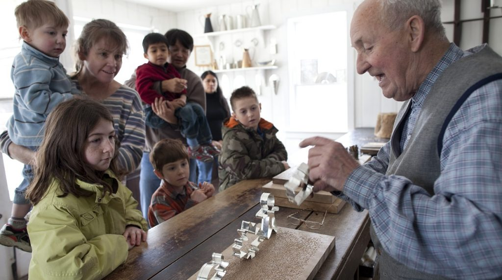 families visit tinsmith shop during Black Creek Village home school day workshop
