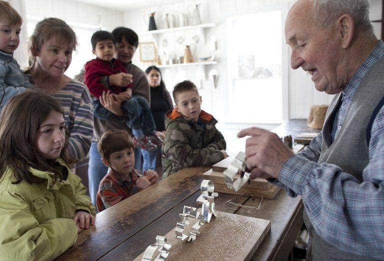 families visit tinsmith shop during Black Creek Village home school day workshop