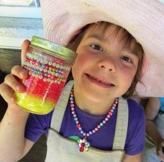 young girl makes crafts at Black Creek Village summer day camp
