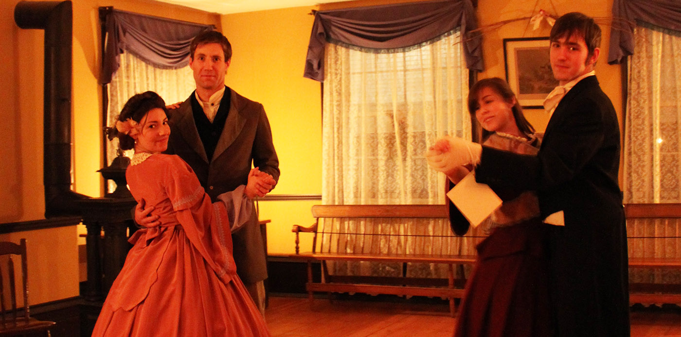 history actors in Victorian costume dancing at Black Creek Village