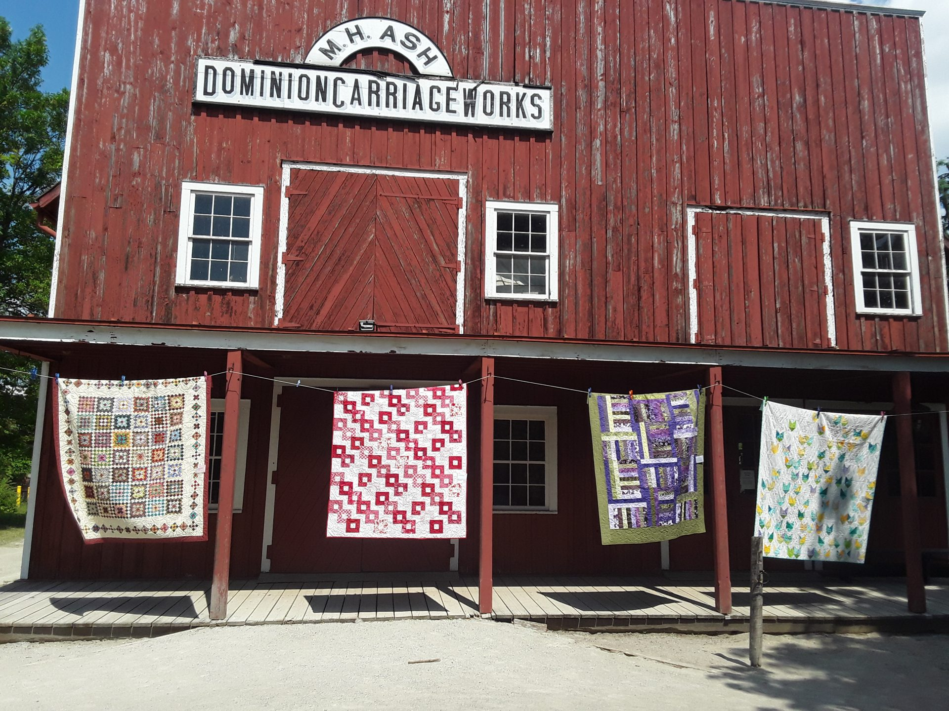 Quilts hanging at the carriage works building