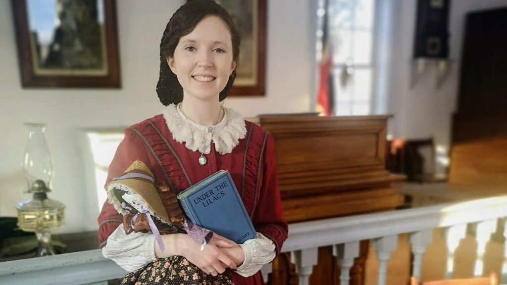A pioneer woman holding a book