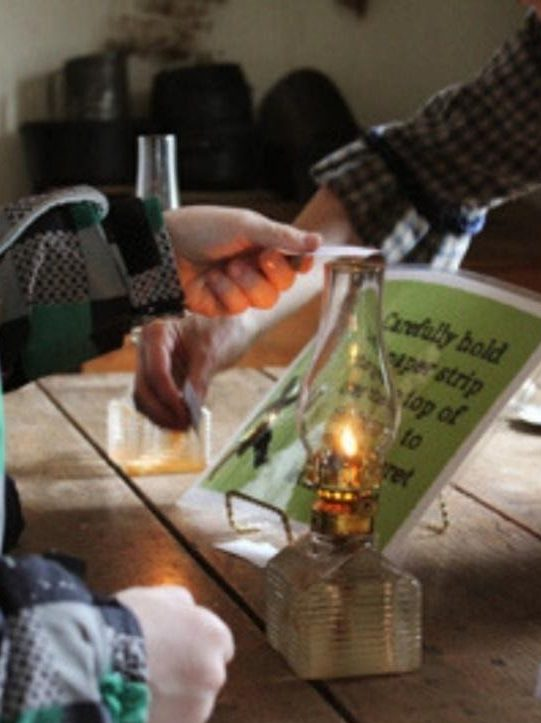 Reading a document with a lantern
