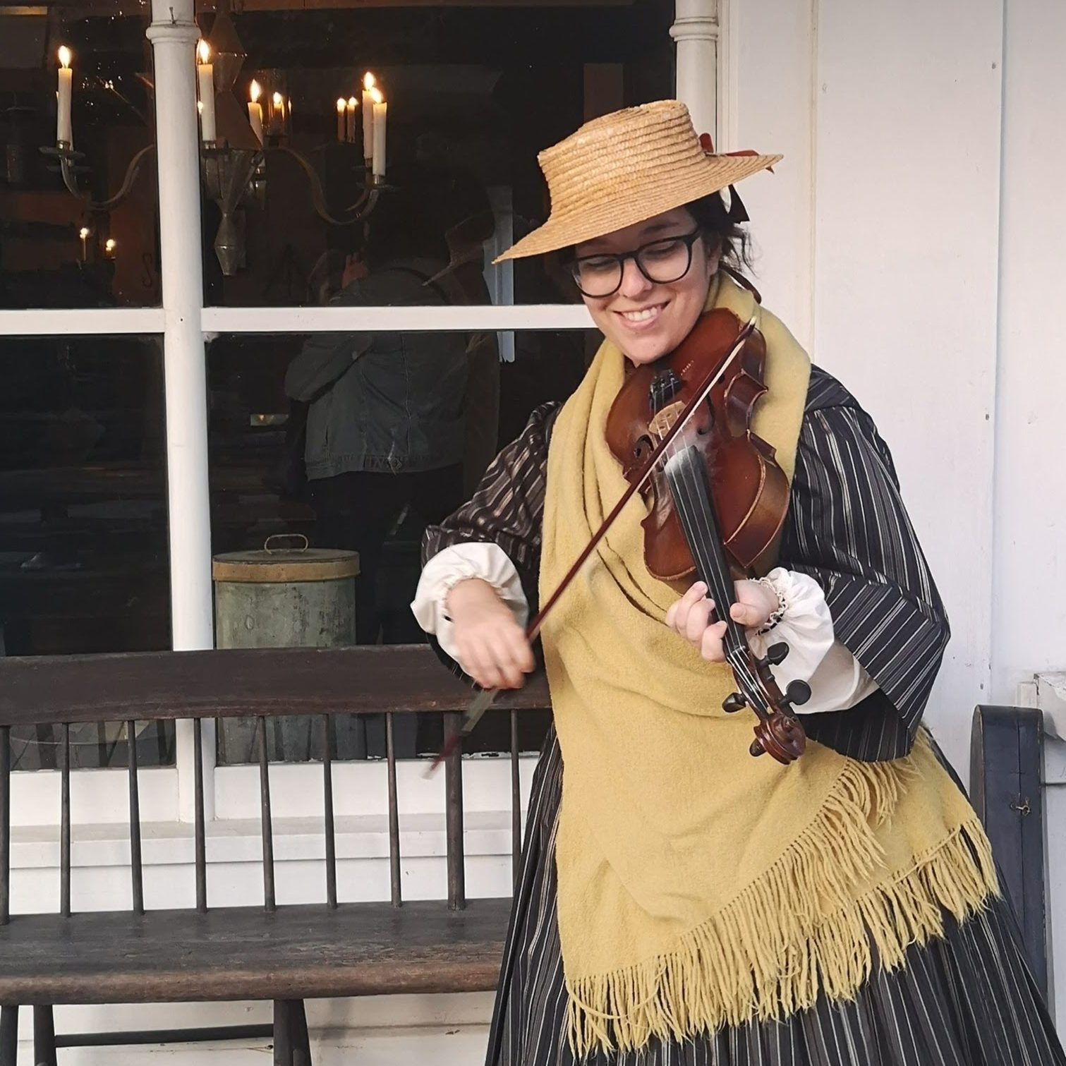 A pioneer woman playing the fiddle