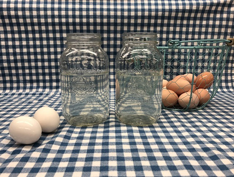 eggs sit next to jars filled with cold water