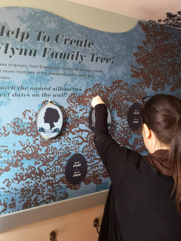 visitor to Flynn House exhibit at Black Creek Pioneer Village examines the family tree
