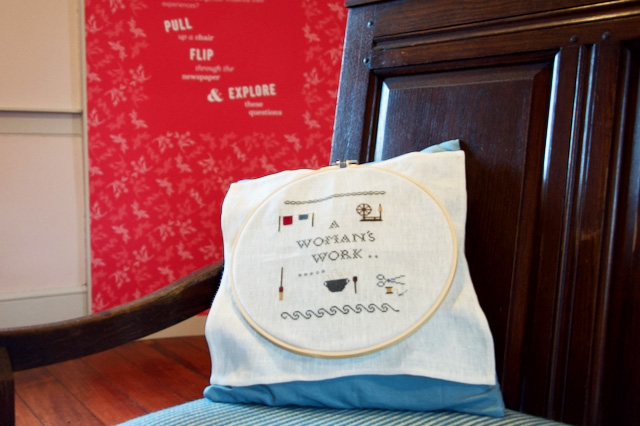 An embroidered pillow in the Girls Bedroom portion of the Flynn House exhibit tells part of the story of women in the 19th century