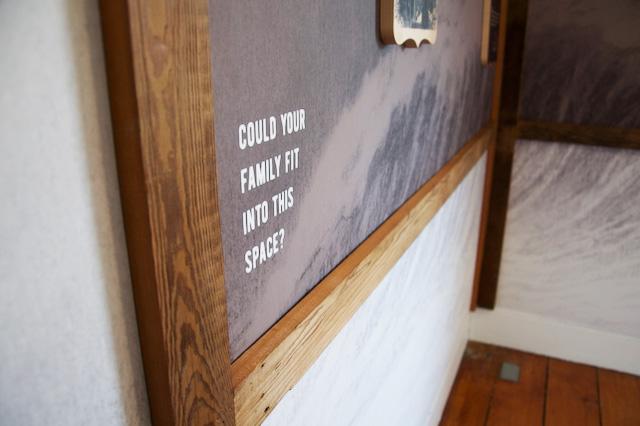 visitor to Flynn House exhibit at Black Creek Pioneer Village explores Travelers Room