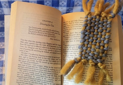 crafter marks page with woven bookmark