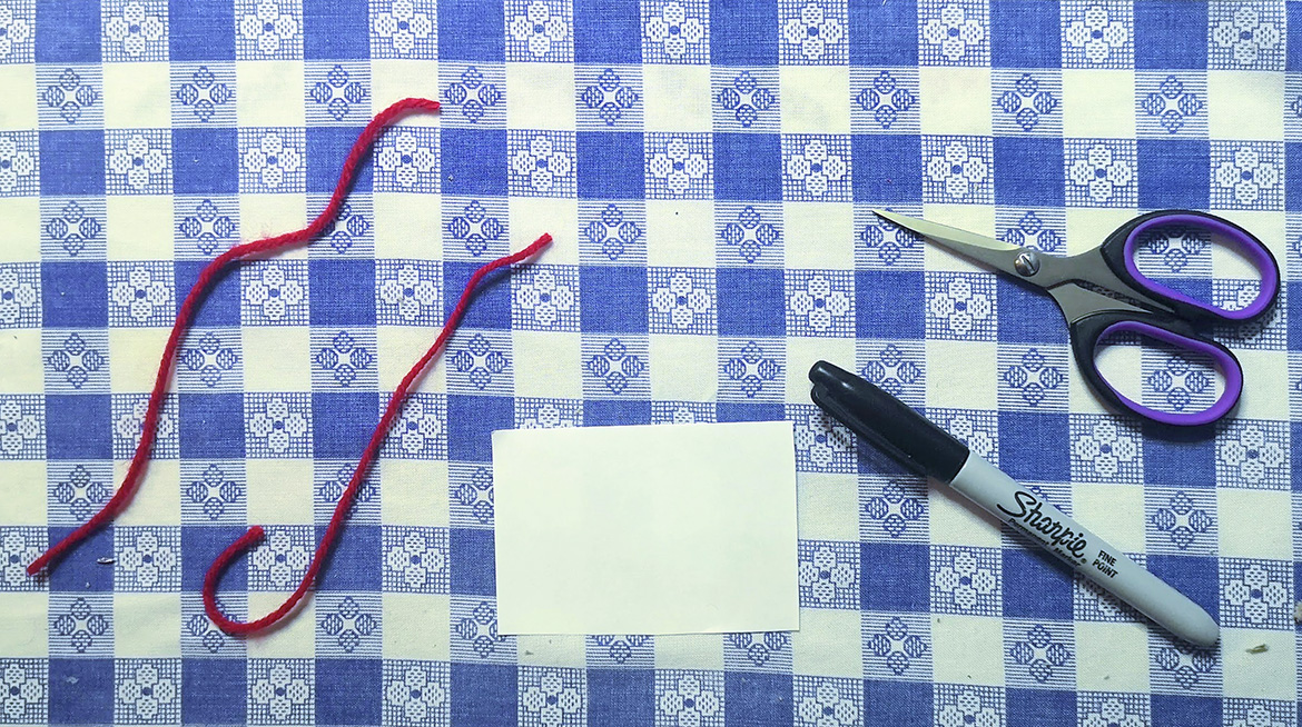 scissors with string and other supplies for making an optical toy