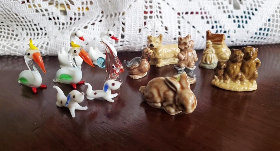 glass animal figurines organized by species