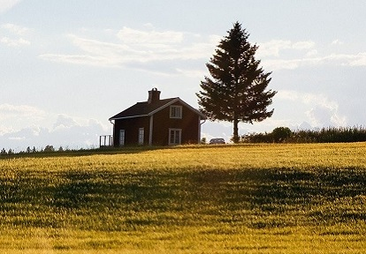 small farm house in field