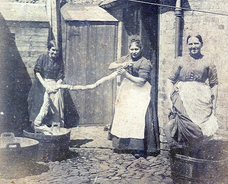 archival photograph of women doing laundry