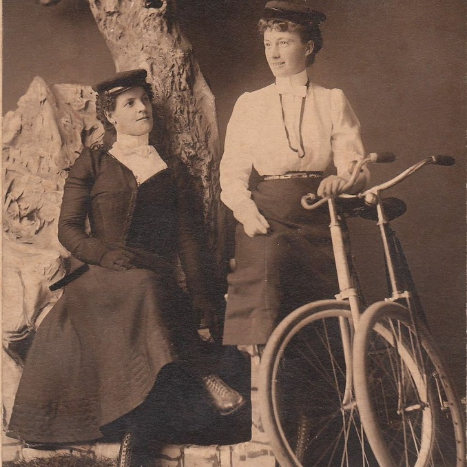 turn of the century photograph of young women dressed for cycling