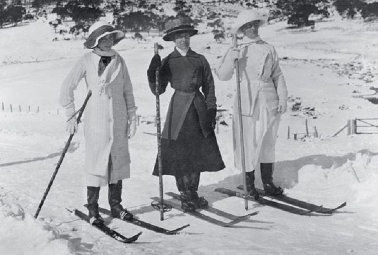 archival photograph of women in early 20th century skiwear