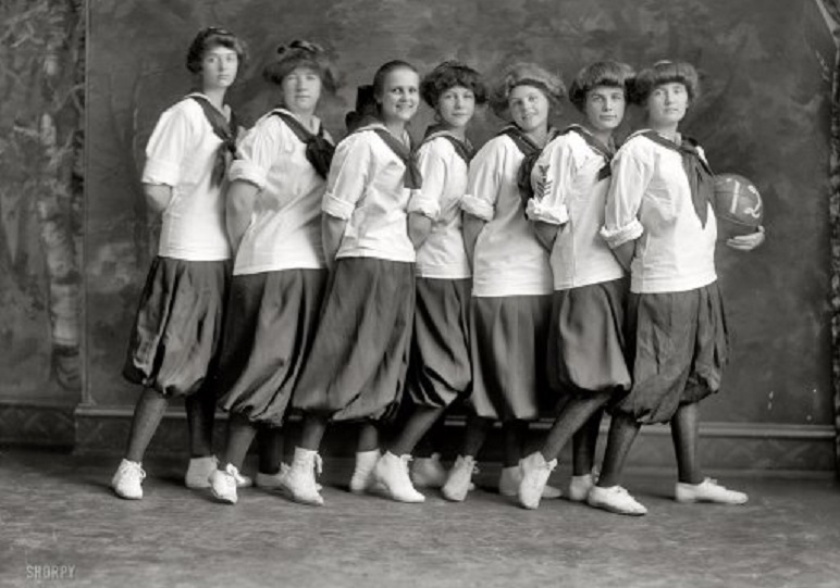 girls basketball team wearing uniform of bloomers and middys