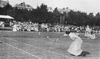 1898 photograph of tennis champion Charlotte Cooper Sterry in action