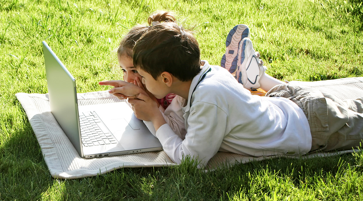 children outdoors with laptop participate in fun virtual summer camp activities from TRCA