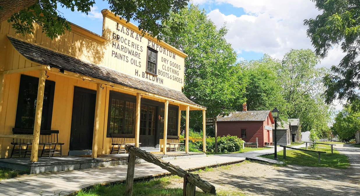 Black Creek Pioneer Village streetscape seen from vicinity of Laskay Emporium on a summer afternoon