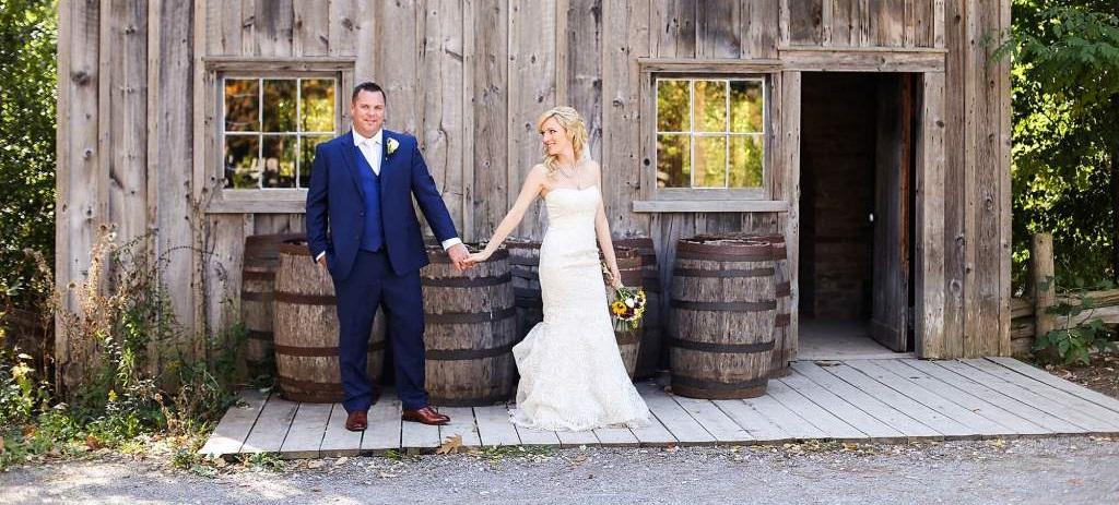newlyweds pose for wedding photograph at Black Creek Pioneer Village