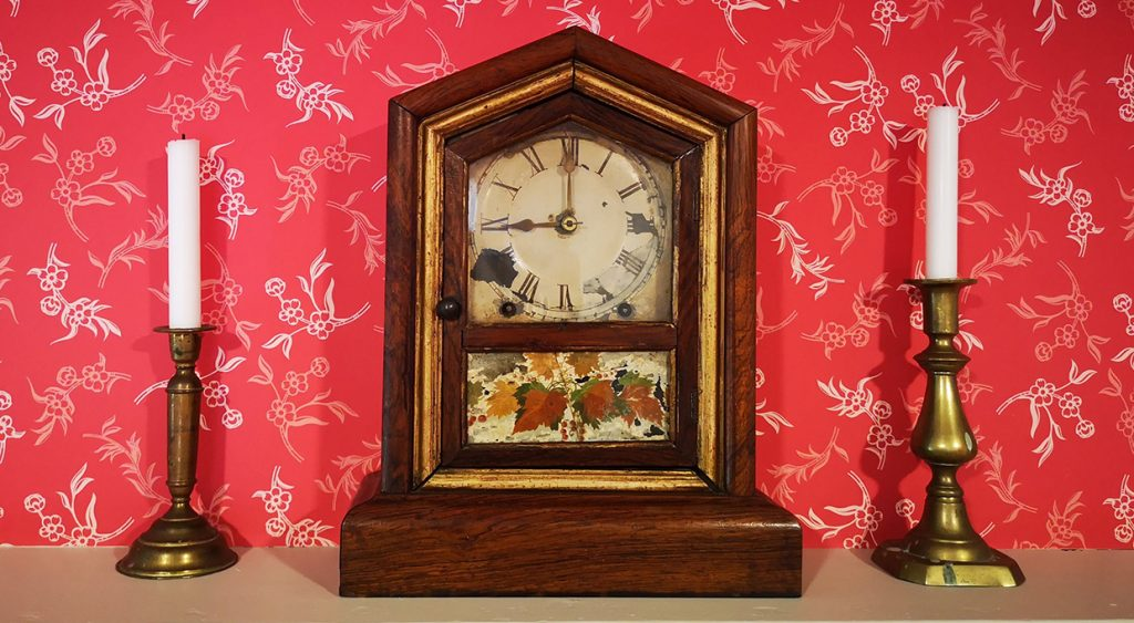 Victorian clock and candlesticks on mantelpiece at Black Creek Pioneer Village