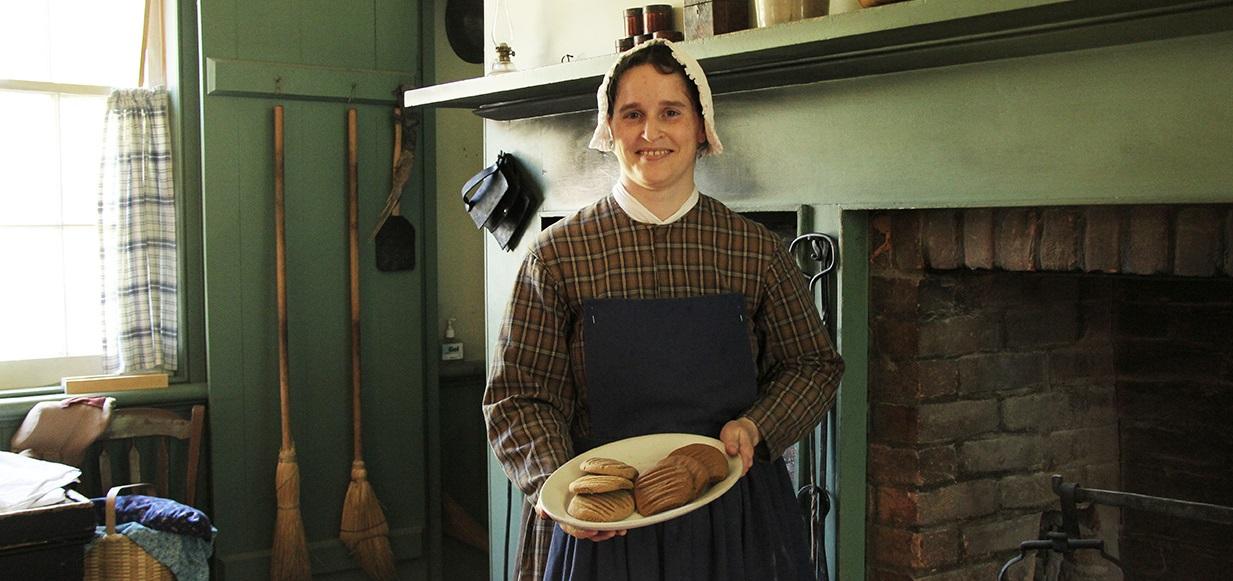 costumed educator presents demonstration of 19th century baking at Black Creek Pioneer Village