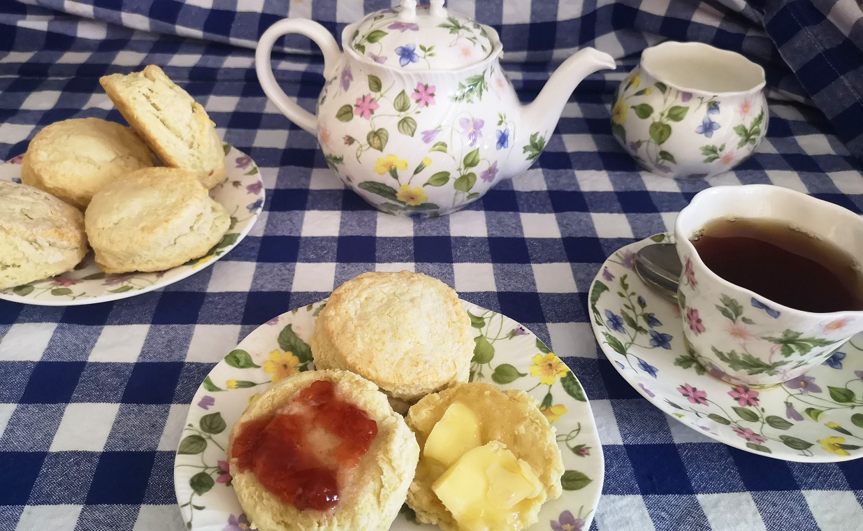 traditional Victorian high tea with jam and biscuits