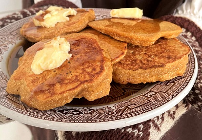 plate of flatjacks with maple syrup and butter