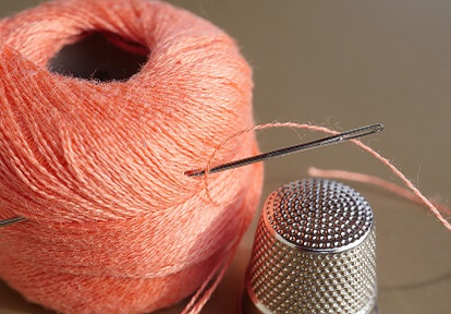 sewing thread with needle and thimble