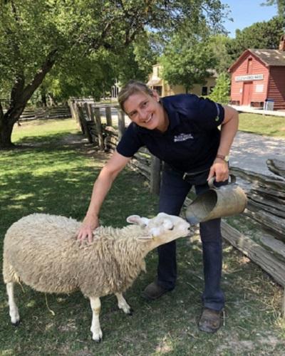Black Creek Pioneer Village team member introduces summer campers to heritage breed sheep