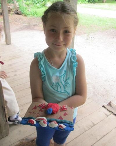 summer camper makes clay art at Black Creek Pioneer Village