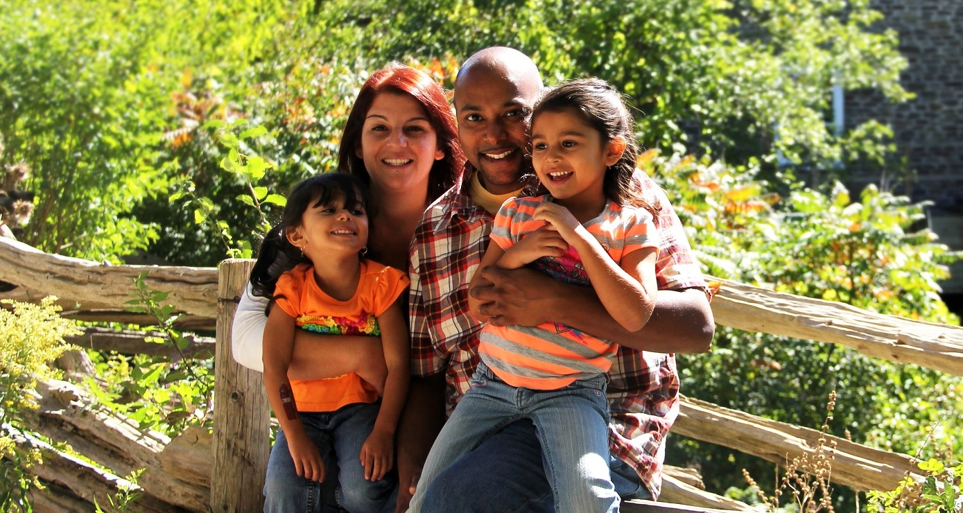 young family enjoys a summertime visit to Black Creek Pioneer Village