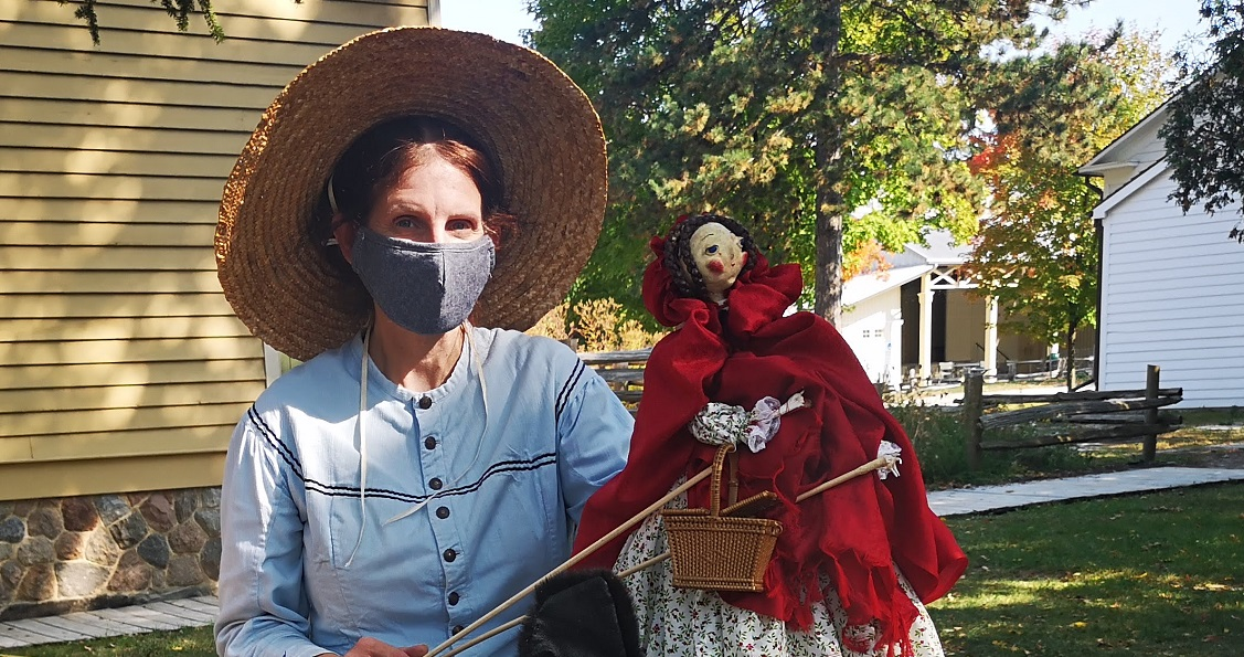 costumed educator at Black Creek Pioneer Village wears mask to protect visitors and other staff